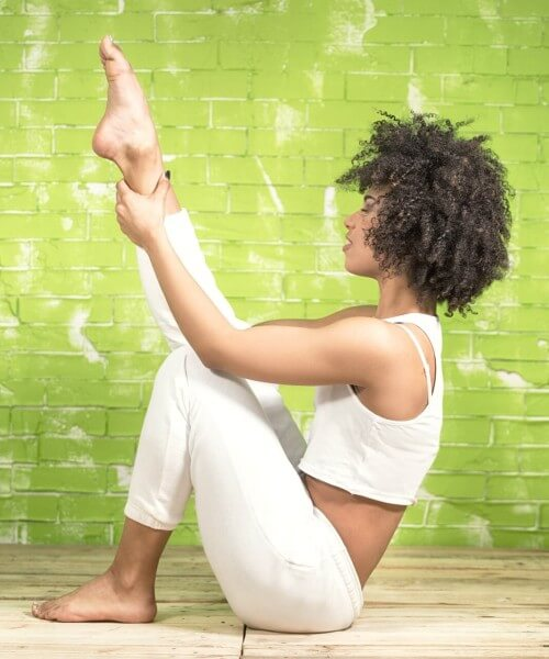 woman sitting on the floor in a yoga pose